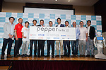(Center) Kenichi Yoshida, vice president of business development for SoftBank Robotics poses for the cameras with guest speakers at Pepper for Biz 2.0 on July 20, 2016, Tokyo, Japan. Yoshida along with other guests spoke about the new features of Pepper such as Chinese response and speech recognition, and duty free tax refunds and electronic payments services, in response to business needs. The presentation was held a day before the start of Pepper World 2016 exhibition, where developers will introduce applications for SoftBank's robot Pepper. Pepper World will run until July 22. (Photo by Rodrigo Reyes Marin/AFLO)