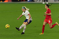 ORLANDO CITY, FL - FEBRUARY 18: Julie Ertz #8 crosses the ball while pressured by Evelyne Viens during a game between Canada and USWNT at Exploria stadium on February 18, 2021 in Orlando City, Florida.