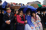 Eton college school, near nr Windsor Berkshire. England<br /> <br /> A rainy afternoon, on Fellow's Eyot, parents and siblings assemble to watch the procession of boats.