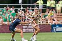 NEWTON, MA - MAY 22: Belle Smith #5 of Boston College on the attack as Diana Kelly #12 of Notre Dame defends during NCAA Division I Women's Lacrosse Tournament quarterfinal round game between Notre Dame and Boston College at Newton Campus Lacrosse Field on May 22, 2021 in Newton, Massachusetts.