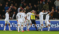 Swansea City players appeal for a penalty against James Collins of West Ham United to referee Lee Mason during the Barclays Premier League match between Swansea City and West Ham United played at The Liberty Stadium, Swansea on 20th December 2015