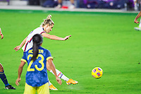 ORLANDO, FL - JANUARY 18: Kristie Mewis #22 of the USWNT kicks the ball during a game between Colombia and USWNT at Exploria Stadium on January 18, 2021 in Orlando, Florida.