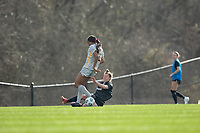 LOUISVILLE, KY - MARCH 13: Savannah McCaskill #7 of Racing Louisville FC slide tackles Gabrielle Robinson #8 of West Virginia University during a game between West Virginia University and Racing Louisville FC at Thurman Hutchins Park on March 13, 2021 in Louisville, Kentucky.