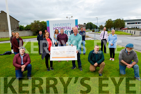 Members of the Ardfert Community Vintage Tractor Run present a cheque for €5,000 to UHK Sports and Social Club on Friday. <br /> Front: Trease Carroll and Brendan Griffin.<br /> Kneeling l to r: Justin Horgan, Martin Woulfe and Eamon Kirby.<br /> Back l to r: Triona Brassil, Margaret Raggett, Maurice J Harmon, Catherine Leen, John McElligott, Jermiah Clifford, Paul McCarthy, David Hobbert and Mairead  Kelliher