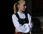 A young Latvian girl stands in front of the souvenir dressed in traditional outfit at the Latvian Open-Air Ethnographic Museum, Riga, May 2013.<br /> <br /> A traditional house in the museum is soon to be renovated thanks to the EEA funds.