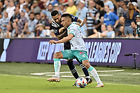 KANSAS CITY, KS - AUGUST 10: Jean Meneses #16 Club Leon with the ball during a game between Club Leon and Sporting Kansas City at Children's Mercy Park on August 10, 2021 in Kansas City, Kansas.