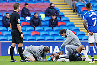Andre Ayew of Swansea City is seen to by Ritson Lloyd and Jez McCluskey, Club Doctor during the Sky Bet Championship match between Cardiff City and Swansea City at the Cardiff City Stadium, Cardiff, Wales, UK. Saturday 12 December 2020