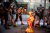 American flags are burned during a Black Lives Matter protest on the July 4 holiday in Manhattan.