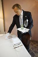 Switzerland. Canton Graubünden. St. Moritz. Hotel Carlton. Butler. Stefan Kleinat dresses the table in the hotel suite. © 2008 Didier Ruef