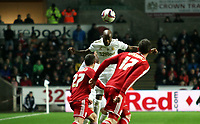 League Cup, Swansea City (white) V Middlesbrough, Liberty Stadium, 12/12/12<br /> Pictured: Dwight Tiendalli leaps highest for the Swans<br /> Picture by: Ben Wyeth<br /> Athena Picture Agency<br /> info@athena-pictures.com