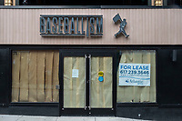 """A sign in the window announces the closure of the Baseballism memorabilia store across the street from Fenway Park in Boston, Massachusetts, seen here on Wed., Jan. 6, 2021. The sign also state that there is """"No cash. No Inventory."""" in the permanently closed store."""