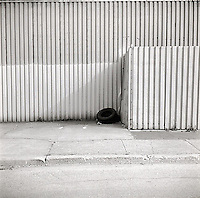 Tire leaning against wall<br />