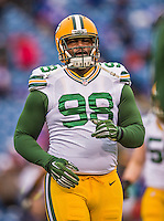 14 December 2014: Green Bay Packers nose tackle Letroy Guion warms up prior to facing the Buffalo Bills at Ralph Wilson Stadium in Orchard Park, NY. The Bills defeated the Packers 21-13, snapping the Packers' 5-game winning streak and keeping the Bills' 2014 playoff hopes alive. Mandatory Credit: Ed Wolfstein Photo *** RAW (NEF) Image File Available ***