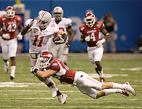Ross Rasner of Arkansas tackles Jake Stoneburner of Ohio State during the game during 77th Annual Allstate Sugar Bowl Classic at Louisiana Superdome in New Orleans, Louisiana on January 4th, 2011.  Ohio State defeated Arkansas, 31-26.