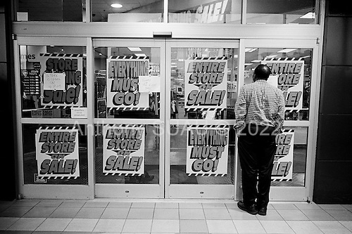 March 7, 2009<br /> Brooklyn, New York<br /> USA<br /> <br /> The last day at Atlantic Avenue's Circuit City before going out of business. All sales are final and everything in the store must go including the fixtures.<br /> <br /> Local residents watch as the doors are permanently closed.