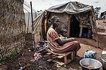 CAR, Bangui: Baovallée has three children but lost her husband. She's from Bosangoa and has been living in the Mpoko camp since December 2013. Behind her, the small tent where she's living with her children.  17th April 2016.<br /> RCA, Bangui : Baovallée a trois enfants, mais a perdu son mari . Elle est de Bosangoa et vit dans le camp Mpoko depuis Décembre 2013. Derrière elle, la petite tente où elle vit avec ses enfants . 17 avril 2016.