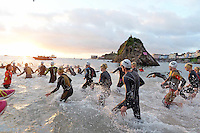 Pictured: Ironman athletes take to the sea in Tenby Pembrokeshire, Wales, UK. SUnday 18 September 2016<br /> Re: The Ironman Wales triathlon has returned to Pembrokeshire for a sixth time.<br /> More than 2,000 endurance athletes are taking on one of the most challenging courses in the sport, starting and finishing in Tenby.<br /> It includes a 2.4 mile (or 3.8km) swim, a 112 mile (or 180km) bike ride and 26.2 mile (or 42km) run within 17 hours.