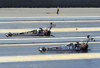 Apr. 14, 2012; Concord, NC, USA: NHRA top fuel dragster driver Tony Schumacher (top) races alongside Tony Schumacher during qualifying for the Four Wide Nationals at zMax Dragway. Mandatory Credit: Mark J. Rebilas-