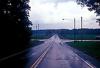 Road intersection and dark stormy sky<br />