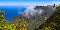 Kalalau Valley with clouds over the cliffs and the Pacific Ocean, from the Pihea Trail near the beautiful Na Pali coast of Kauai Island, Hawaii