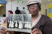 Catherine Harris, who worked at St.Mary's Hospital, Harrow Road, for 22 years, with a photograph of her wedding at St.Simon's Church in Saltram Crescent in 1957.  Open Age reminiscence session at the WECH Community Centre.