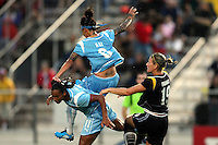 Natasha Kai (6) and Rosana (11) of Sky Blue get tangled after Martina Franko (19) of the Sol heads the ball away.   Sky Blue played to a 0-0 tie against the LA Sol Saturday, June 13, in Piscataway, NJ.