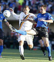 22 May 2004: Earthquakes Ryan Cochrane battles for the ball against Galaxy forward Alejandro Moreno at Spartan Stadium in San Jose, California.   Earthquakes defeated Galaxy 4-2. Mandatory Credit: Michael Pimentel / ISI