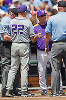 LSU Tigers Head Coach Paul Mainieri (1) exchanges line-up cards with TCU Horned Frogs Head Coach Jim Schlossnagle (22) before the NCAA College World Series game on June 14, 2015 at TD Ameritrade Park in Omaha, Nebraska. TCU defeated LSU 10-3. (Andrew Woolley/Four Seam Images)