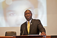 """Benjamin Crump attorney for the families of Trayvon Martin and Mike Brown speaking at """"Checking Under the Hood: Defining Trayvon Martin's Legacy, From Conversation to Legislation"""" at Harvard Law School Cambridge MA with Sybrina Fulton Trayvon Martin's mother hosted by Professor Charles Ogletree of the Charles Hamilton Houston Institute at Austin Hall Ames Courtroom November 18, 2013"""