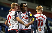 Bolton Wanderers' Eoin Doyle (left) celebrates scoring his side's first goal with team mate Peter Kioso (centre) and Ali Crawford  <br /> <br /> Photographer Andrew Kearns/CameraSport<br /> <br /> The EFL Sky Bet League Two - Bolton Wanderers v Salford City - Friday 13th November 2020 - University of Bolton Stadium - Bolton<br /> <br /> World Copyright © 2020 CameraSport. All rights reserved. 43 Linden Ave. Countesthorpe. Leicester. England. LE8 5PG - Tel: +44 (0) 116 277 4147 - admin@camerasport.com - www.camerasport.com