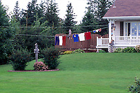 Cap-Egmont, PEI, Prince Edward Island, Canada - Blue, White, and Red / Bleu, Blanc, Rouge (Acadian Colours) Clothing hanging on Clothes Line as Decoration for Annual National Acadian Festival