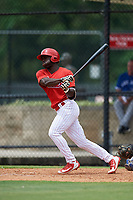GCL Phillies East right fielder James Smith (22) follows through on a swing during a game against the GCL Blue Jays on August 10, 2018 at Carpenter Complex in Clearwater, Florida.  GCL Blue Jays defeated GCL Phillies East 8-3.  (Mike Janes/Four Seam Images)