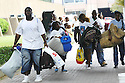 Residents seeking shelter gathered at the Louisiana Superdome Sunday afternoon before Hurricane Katrrina, 2005.