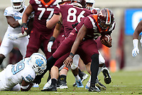 BLACKSBURG, VA - OCTOBER 19: Herndon Hooker #2 of Virginia Tech tries to pull his leg free from Storm Duck #29 of the University of North Carolina during a game between North Carolina and Virginia Tech at Lane Stadium on October 19, 2019 in Blacksburg, Virginia.