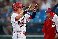 Auburn Doubledays right fielder Jacob Rhinesmith (18) is congratulated by his teammate as he returns to the dugout after hitting a home run in the bottom of the first inning during a game against the Hudson Valley Renegades on September 5, 2018 at Falcon Park in Auburn, New York.  Hudson Valley defeated Auburn 11-5.  (Mike Janes/Four Seam Images)