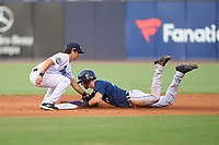 Tampa Tarpons shortstop Josh Smith (20) attempts to tag Gage Workman (27) as he steals second base during a game against the Lakeland Flying Tigers on June 1, 2021 at George M. Steinbrenner Field in Tampa, Florida.  (Mike Janes/Four Seam Images)