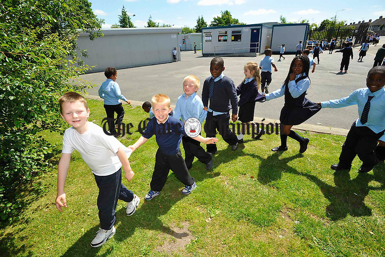 Pupils playing schoolyard games at Scoil Criost Ri Cloughleigh. Photograph by John Kelly.