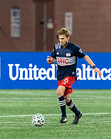 FOXBOROUGH, MA - OCTOBER 3: Scott Caldwell #6 of New England Revolution brings the ball forward during a game between Nashville SC and New England Revolution at Gillette Stadium on October 3, 2020 in Foxborough, Massachusetts.