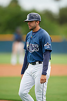 GCL Rays coach Rafael Valenzuela (21) during a Gulf Coast League game against the GCL Pirates on August 7, 2019 at Charlotte Sports Park in Port Charlotte, Florida.  GCL Rays defeated the GCL Pirates 5-3 in the second game of a doubleheader.  (Mike Janes/Four Seam Images)