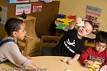 Educaton preschool  3-4 year olds imagination boy making wood puzzle piece flying vocalizing horizontal