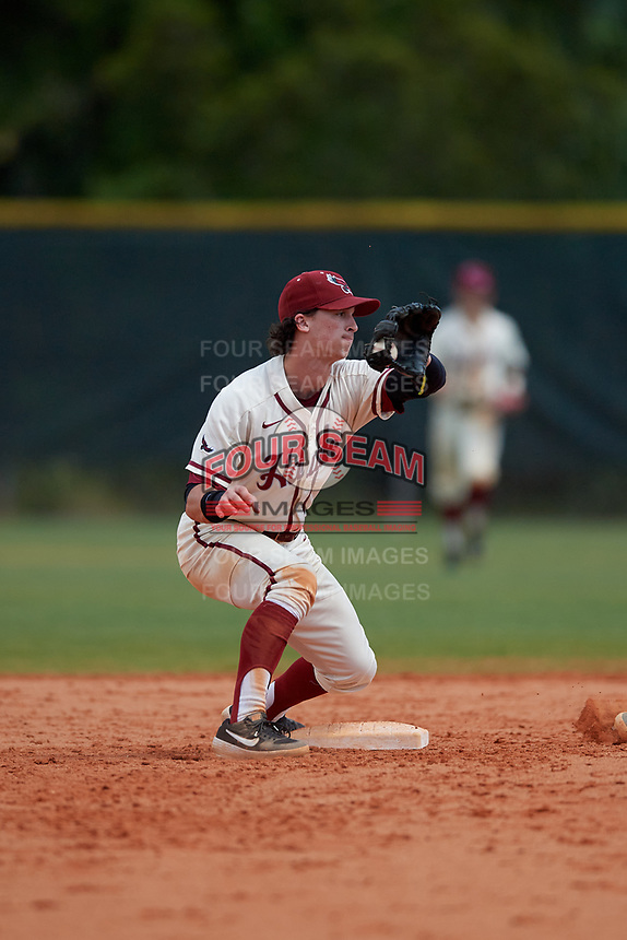 Saint Joseph's Hawks shortstop Liam Bendo (5) catches a throw during a game against the Ball State Cardinals on March 9, 2019 at North Charlotte Regional Park in Port Charlotte, Florida.  Ball State defeated Saint Joseph's 7-5.  (Mike Janes/Four Seam Images)