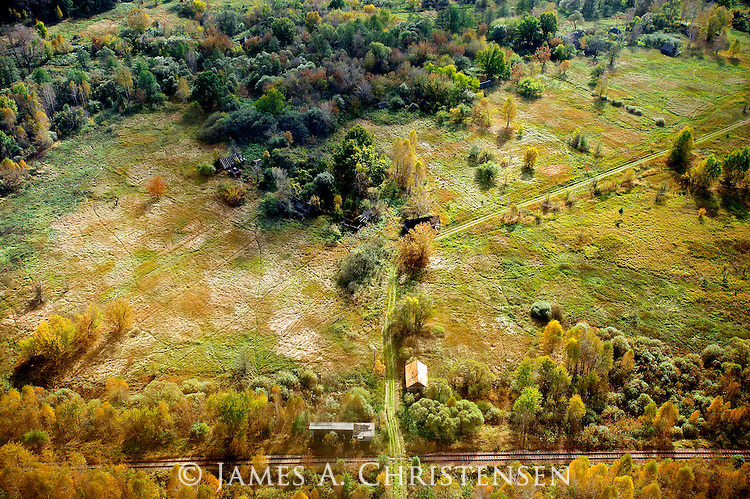 Abandoned village within the Zone of Alienation, west of the Chernobyl Nuclear Power Plant, Ukraine. This image was shot from a Ukrainian government helicopter during a survey of the Chernobyl Exclusion Zone in October, 2012.