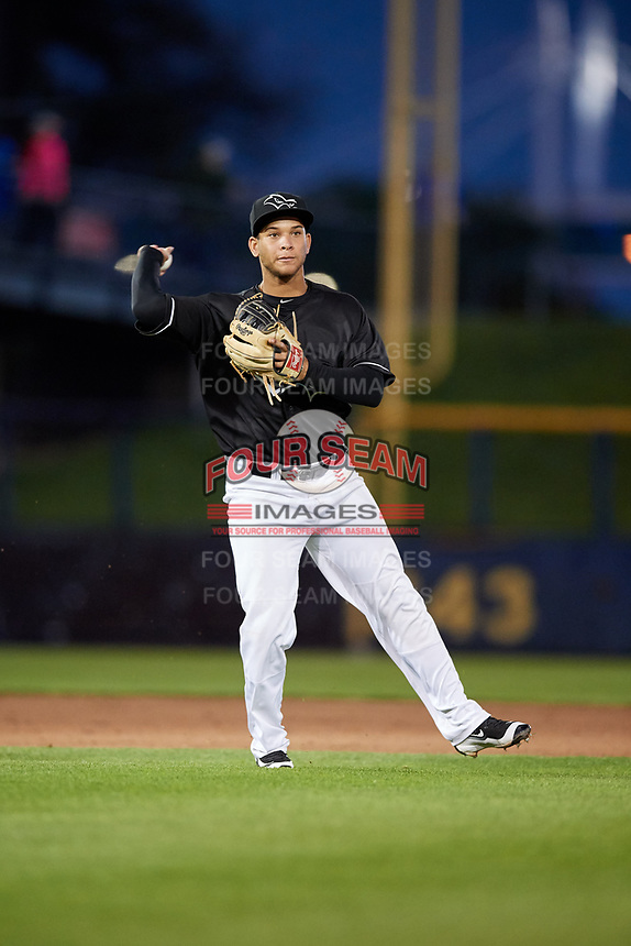 Quad Cities River Bandits third baseman Randy Cesar (30) throws to first base during a game against the Lake County Captains on May 6, 2017 at Modern Woodmen Park in Davenport, Iowa.  Lake County defeated Quad Cities 13-3.  (Mike Janes/Four Seam Images)