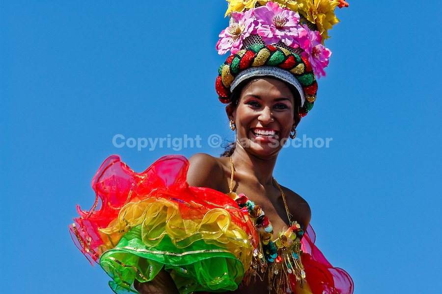 A Colombian girl, having a flower costume, performs on the top of the allegorical float during the Carnival in Barranquilla, Colombia, 27 February 2006. The Carnival of Barranquilla is a unique festivity which takes place every year during February or March on the Caribbean coast of Colombia. A colourful mixture of the ancient African tribal dances and the Spanish music influence - cumbia, porro, mapale, puya, congo among others - hit for five days nearly all central streets of Barranquilla. Those traditions kept for centuries by Black African slaves have had the great impact on Colombian culture and Colombian society. In November 2003 the Carnival of Barranquilla was proclaimed as the Masterpiece of the Oral and Intangible Heritage of Humanity by UNESCO.