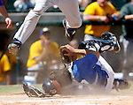 Fort Worth Cats' catcher Osiel Flores is run over by Sioux Falls' Ben Van Iderstine as he makes a tag at home in the fifth inning of a baseball game on Sunday, May 11, 2008.  (photo by Khampha Bouaphanh)