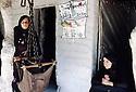 Irak 1985   Dans les zoines libérees du Lolan, deux femmes devant leur maison   Iraq 1985  In Lolan, 2 women in front their house