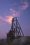 Gold mine headframe at sundown, Goldfield, Nev.