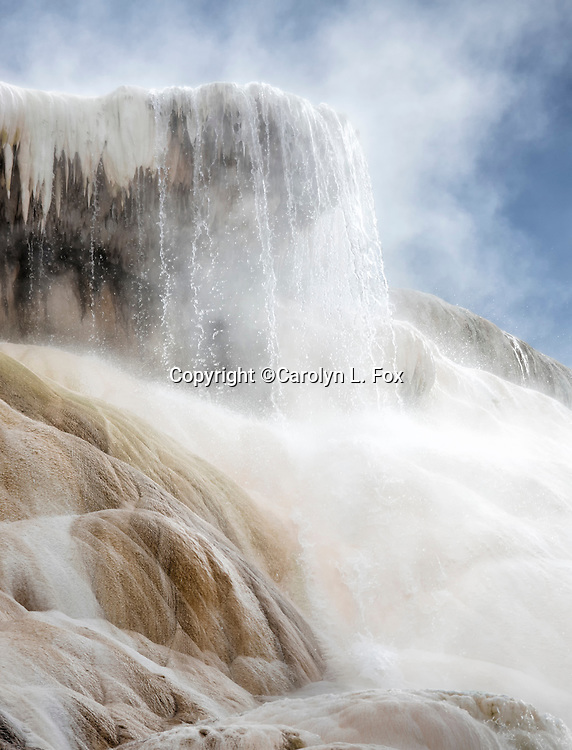 Water pours over a terrace at Mammoth Hot Springs in Yellowstone National Park.