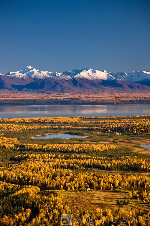 Aerial photo of the lakes and birch forests at Point Mackenzie on the opposite side of Knik Arm from Anchorage with the Chugach Mountains in the background, Fall, Southcentral Alaska, USA.