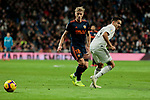 Real Madrid's Sergio Reguilon and Valencia CF's Daniel Wass during La Liga match between Real Madrid and Valencia CF at Santiago Bernabeu Stadium in Madrid, Spain. December 01, 2018. (ALTERPHOTOS/A. Perez Meca)